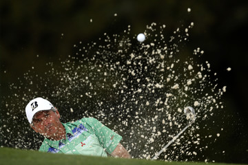 Fred Couples of the U.S. hits from a sand trap on the 18th green during first round play in the 2013 Masters golf tournament in Augusta