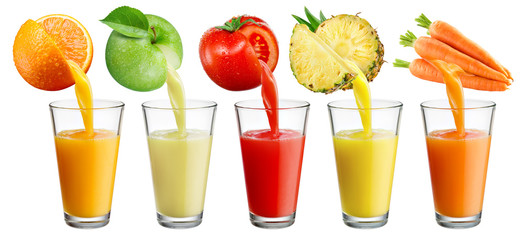 fresh juice pours from fruit and vegetables into the glass isolated