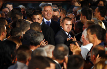 Milo Djukanovic (C), leader of the Democratic Party of Socialists (DPS), arrives at a campaign rally in Berane