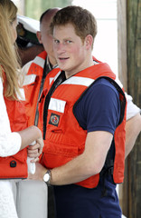 Britain's Prince Harry, wearing a lifejacket, leaves after a tour of Harbour Island in Nassau