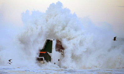 "Waves are seen breaking against the Spanish cargo ship ""Luno"" the day after it broke in two on a seawall off the beach in Anglet on the Atlantic Coast of France"