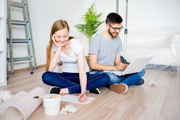 Couple renovating apartment