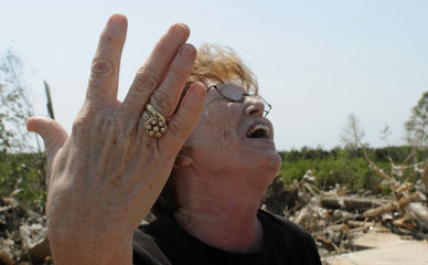 Brenda Roberts reacts after her wedding ring was found in the rubble of her home which was destroyed by a tornado in Phil Campbell