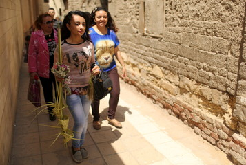 An Egyptian Coptic Christian girl carries palm decoration during Palm Sunday inside a church in Old Cairo