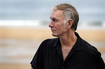 U.S. film director Sayles poses on the seventh day of the 58th San Sebastian Film Festival.