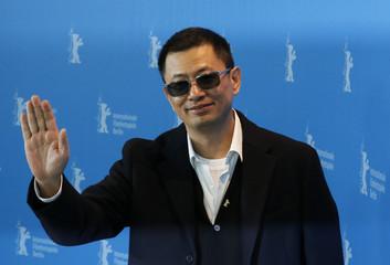 Director Wong Kar Wai poses during photocall in Berlin