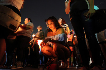 Puerto Ricans gather for a vigil in memory of the victims of the Pulse gay night club shooting in San Juan