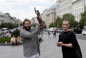 Russian performance artist Peter Pavlensky hands over the Vaclav Havel Prize for Creative Dissent to Russian businessman Yevgeni Chichvarkin in Prague