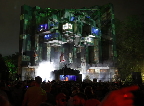 A view shows a light show projected above a DJ booth in Block 9 field during the Glastonbury music festival in Somerset