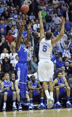 Wildcats' Liggins shoots a three-pointer over Tar Heels' Marshall during their NCAA East Regional game in Newark