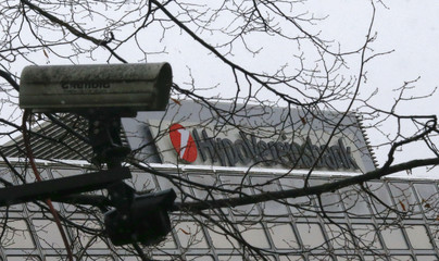 A CCTV camera is pictured next to the logo of UniCredit SpA's German unit HVB in Munich
