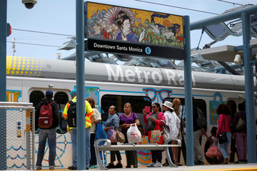 People wait to get on the train at the Downtown Santa Monica station on L.A. Metro's new $1.5 billion Expo Line extension that connects downtown to the beach for the first time in 63 years, in Santa Monica