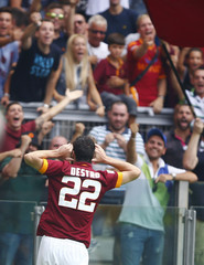 AS Roma's Mattia Destro celebrates after scoring against Cagliari during their Italian Serie A soccer match at the Olympic stadium in Rome