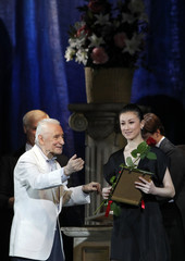 Grigorovich, chairman of jury of Benois de la Danse, presents Zhu, prima ballerina of National Ballet of China, as top ballerina of year in Moscow