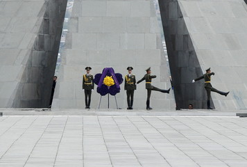Honor guards take part in a commemoration ceremony to mark the centenary of the mass killing of Armenians by Ottoman Turks at the Tsitsernakaberd Memorial Complex in Yerevan