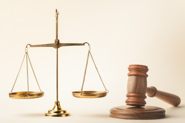 Scales and wooden gavel.