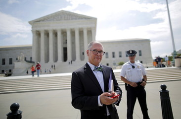 Obergefell walks out of the U.S. Supreme Court in Washington