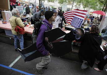 A man carries a cardboard replica of President Obama at the Occupy Wall St. protests in New York's Zucotti Park