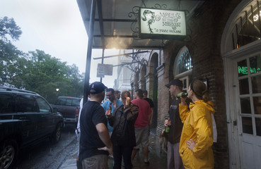 Patrons drink outside a French Quarter bar during Tropical Storm Isaac in New Orleans