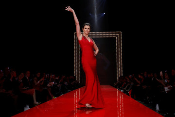 Actor Bridget Moynahan takes part in the American Heart Association's Go Red For Women Red Dress Fall/Winter show during New York Fashion Week in the Manhattan borough of New York