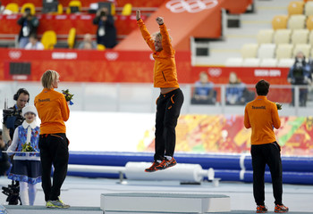 Winner of the men's 500 meters speed skating competition Michel Mulder of the Netherlands celebrates at the flower ceremony for the event at the 2014 Sochi Winter Olympics