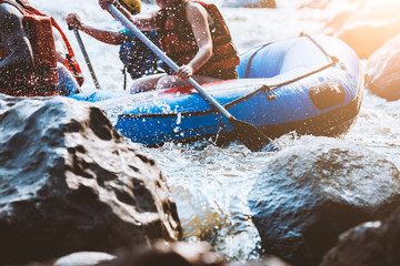 Young person rafting on the river, extreme and fun sport at tourist attraction Wall mural