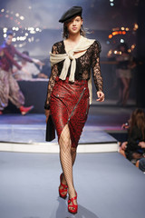 A model presents a creation by Jean Paul Gaultier as part of his Spring/Summer 2014 women's ready-to-wear fashion show during Paris fashion week
