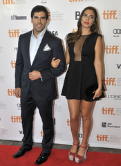 """Actors Eli Roth and Lorena Izzo pose at the gala presentation for the film """"The Impossible"""" at the Toronto International Film Festival"""