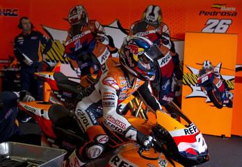 Honda MotoGP rider Pedrosa rides his bike in the garage during the qualifying practice of the Spanish Grand Prix in Jerez de la Frontera
