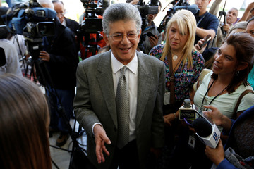Henry Ramos Allup, president of the National Assembly and deputy of the MUD, arrives for a news conference at the National Assembly building in Caracas