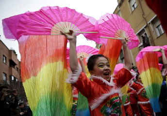 Girls perform during a parade to celebrate the Chinese Lunar New Year, which welcomes the Year of the Monkey, in Madrid, Spain