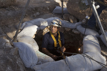 Distenfeld from the Israel Antiquities Authority rappels down an ancient well uncovered in recent excavations in Jezreel Valley