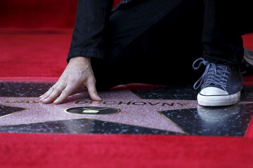 Actor Duchovny poses on his star after it was unveiled on the Hollywood Walk of Fame in Los Angeles