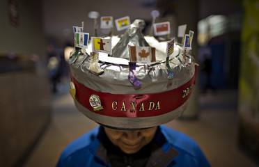Eldora Paterson shows off her homemade hat designed like a curling stone during the Canadian Men's Curling Championships in Edmonton