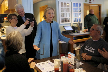 U.S. Democratic presidential candidate Hillary Clinton and her husband, former U.S. President Bill Clinton, greet diners at the Chez Vachon restaurant in Manchester