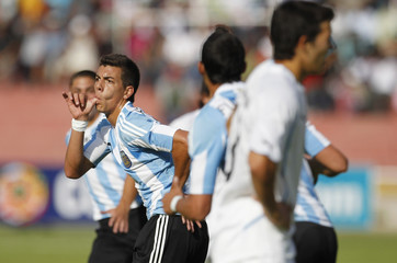 Argentina's Michael Hoyos celebrates his first against Uruguay in their Group A soccer match at the Conmebol U-20 championship in Arequipa