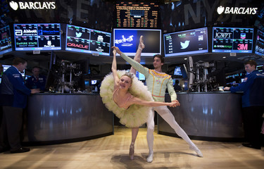 """Dancers from the New York City Ballet's production of """"The Nutcracker"""" pose for photos on the floor of the New York Stock Exchange in New York"""