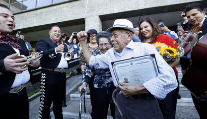 Fabio Alvarado, who was sworn in as a US citizen on election day, arrives to vote during the presidential election at LA County Registrar Office in Los Angeles