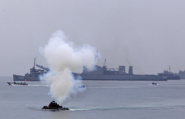 A LVT-E1 armored vehicle releases smoke as it approaches the beach during a raid as part of the 2010 Han Kuang military exercise in Pingtung