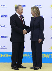 Kazakhstan's President Nazarbayev welcomes U.S. Secretary of State Clinton during the OSCE Summit in Astana