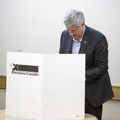 Canada's PM and Conservative leader Harper casts his ballot at a polling station in Calgary