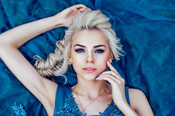 Beautiful young blonde woman face top view