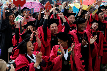 Graduating students from the School of Education cheer as they receive their degrees during the 366th Commencement Exercises at Harvard University in Cambridge