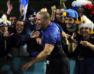 France's Fabien Barcella celebrates with fans after beating Canada in their Rugby World Cup Pool A match at McLean Park in Napier