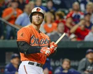 Baltimore Orioles Chris Davis watches the barrel fly into the stands after Boston Red Sox Jon Lester broke his bat during their MLB game in Baltimore