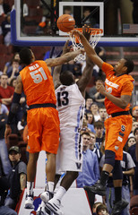 Villanova forward Yarou is blocked as he shoots by Syracuse center Melo and forward Joseph during their NCAA basketball game in Philadelphia