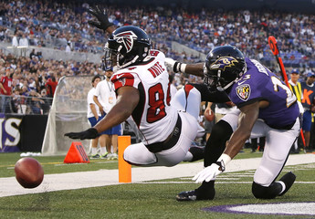 Falcons' White is unable to catch a pass in the end zone as he is defended by Ravens' Brown during the first half of their NFL pre-season football game in Baltimore
