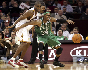 Boston Celtics' Paul Pierce loses control of the ball while guarded by Cleveland Cavaliers' Antawn Jamison during the fourth quarter of their NBA basketball game in Cleveland