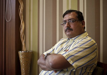 Indian businessman Bansal poses for a picture inside his office in New Delhi