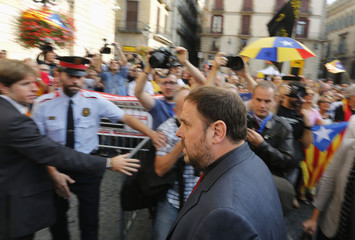 Catalonia's Republican Left leader Junqueras arrives at Palau de la Generalitat (Government Palace) before Catalonia's President Mas signs a decree calling for an independence referendum, in Barcelona